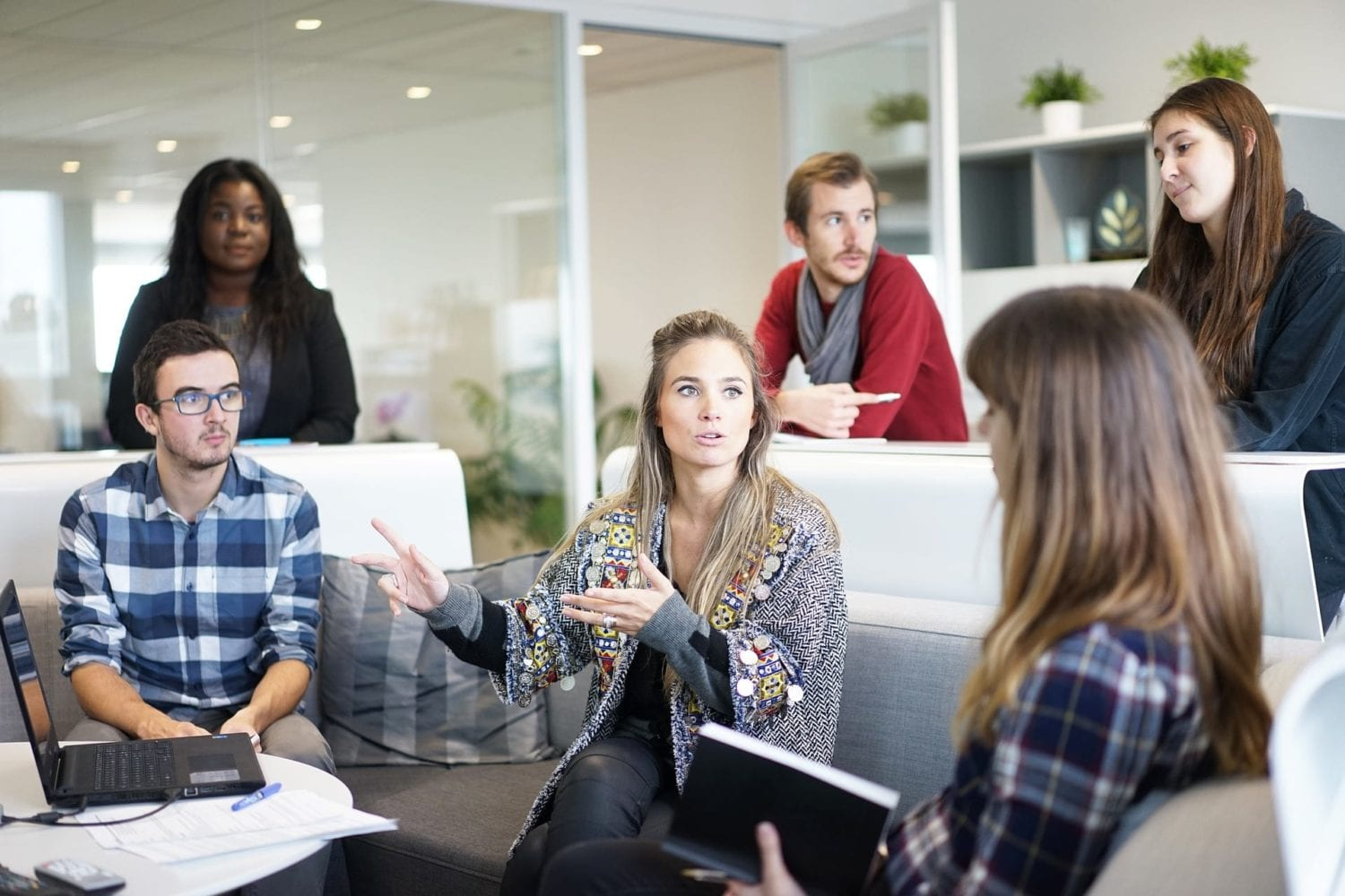 Young business people in an office discussing how to get more leads